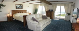 Suite 1 is extremely large with Super King sleep,  settee and private balcony